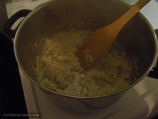 Λουκάνικα με πιπεριές και ρύζι - Βήμα 13