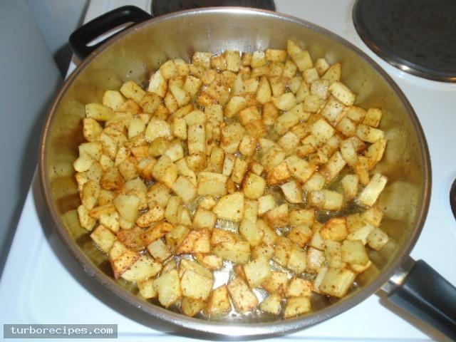 Μεξικάνικες πατάτες με λιωμένο τυρί τσένταρ, σκόρδο και κύμινο - Βήμα 10