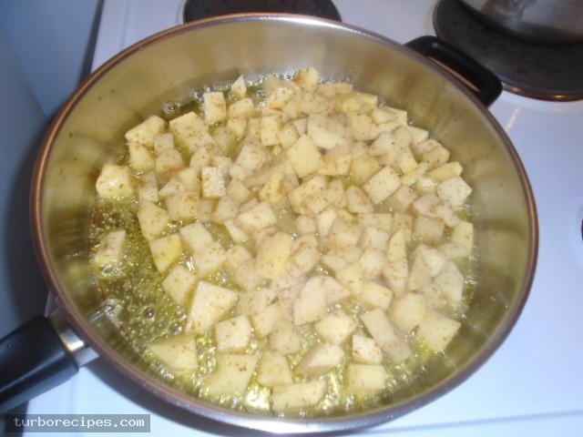 Μεξικάνικες πατάτες με λιωμένο τυρί τσένταρ, σκόρδο και κύμινο - Βήμα 12
