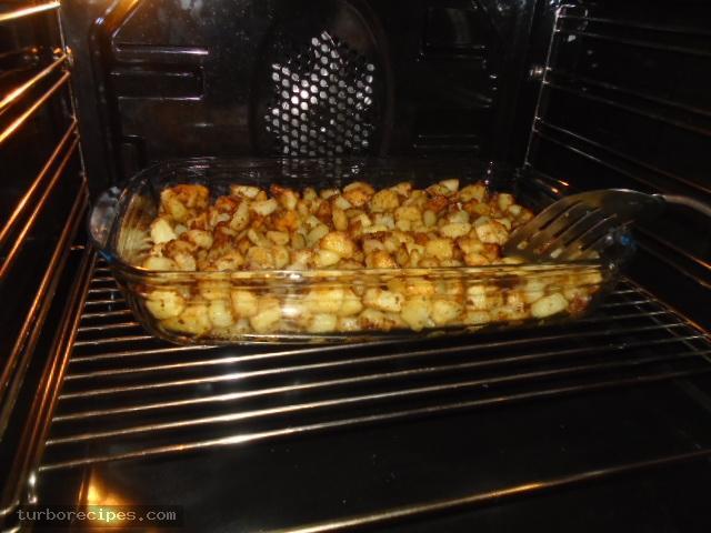 Μεξικάνικες πατάτες με λιωμένο τυρί τσένταρ, σκόρδο και κύμινο - Βήμα 17