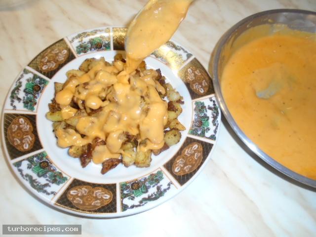 Μεξικάνικες πατάτες με λιωμένο τυρί τσένταρ, σκόρδο και κύμινο - Βήμα 22