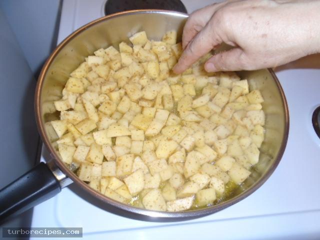 Μεξικάνικες πατάτες με λιωμένο τυρί τσένταρ, σκόρδο και κύμινο - Βήμα 8
