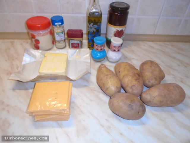Μεξικάνικες πατάτες με λιωμένο τυρί τσένταρ, σκόρδο και κύμινο - Υλικά συνταγής